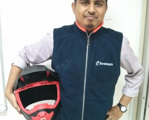 3D Printed Motorcross Helmet - Ezrul holding helmet